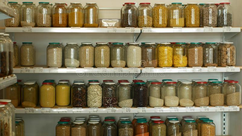 Shop raw materials without packaging, healthy nutrition wide assortment of cereals, legumes, dried fruits in jars and royalty free stock image