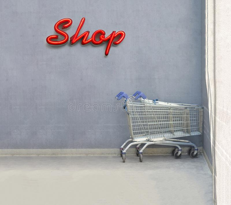 Shop retail concept. With chrome shopping cart royalty free stock images