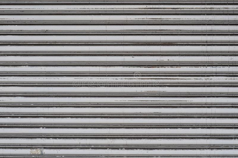 Shop`s iron curtain. Shop`s grey iron curtain in Saigon royalty free stock images