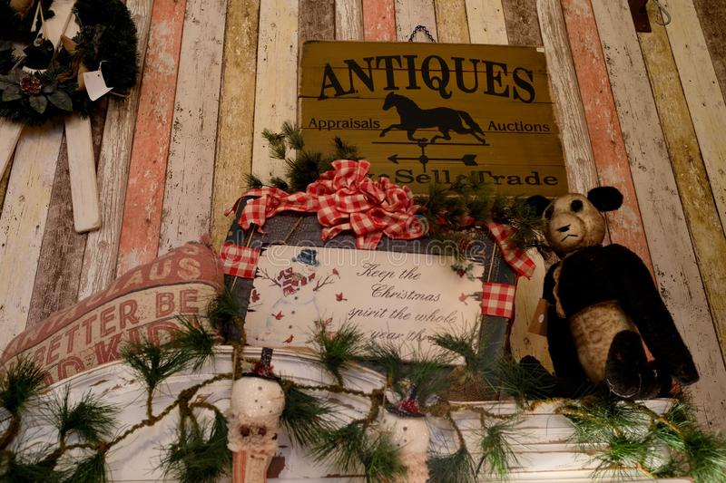 Shop Sell Trade Vintage Items and Antiques. Display of vintage items and antiques, toys and Christmas decorations, and sign for antique appraisals, auctions stock images
