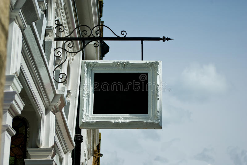 Shop sign. Blank shop sign, urban scene royalty free stock images