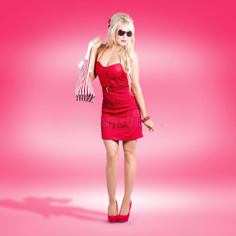 Shop Till You Drop. Female Retail Shopper In Red Royalty Free Stock Photo