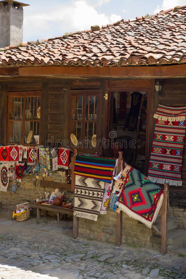 Shop traditional homespun rugs in the Bulgarian village of Zheravna royalty free stock photography