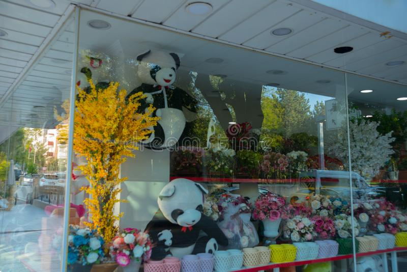 Shop window with flowers and soft Panda toy. Ankara, Turkey stock photos