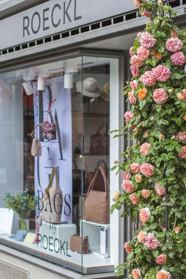 Shop windows and flowers in Zurich. stock image