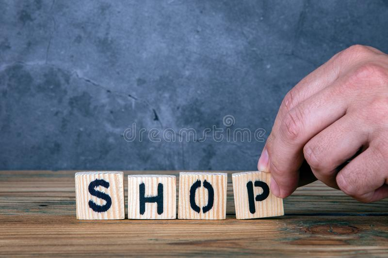 Shop - word from wooden letters stock photography