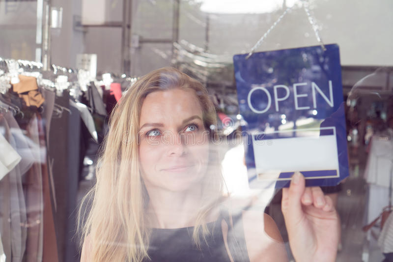 Shop worker with the open and closed sign royalty free stock photos