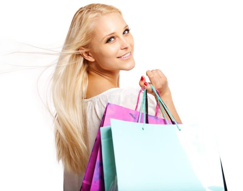 Shopaholic bonito isolado no branco foto de stock