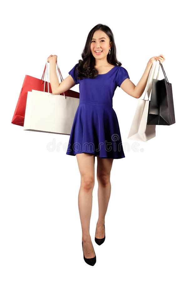 Shopaholic-Frau mit Einkaufstaschen lizenzfreie stockfotografie