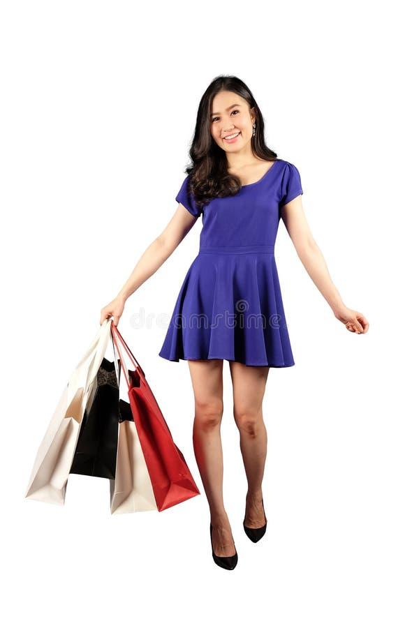 Shopaholic-Frau mit Einkaufstaschen lizenzfreie stockbilder