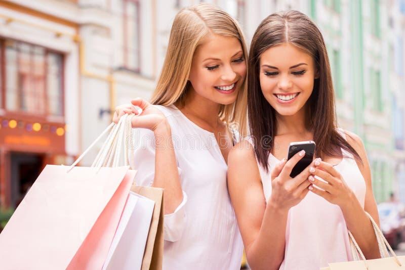 Shopaholic friends. stock photos