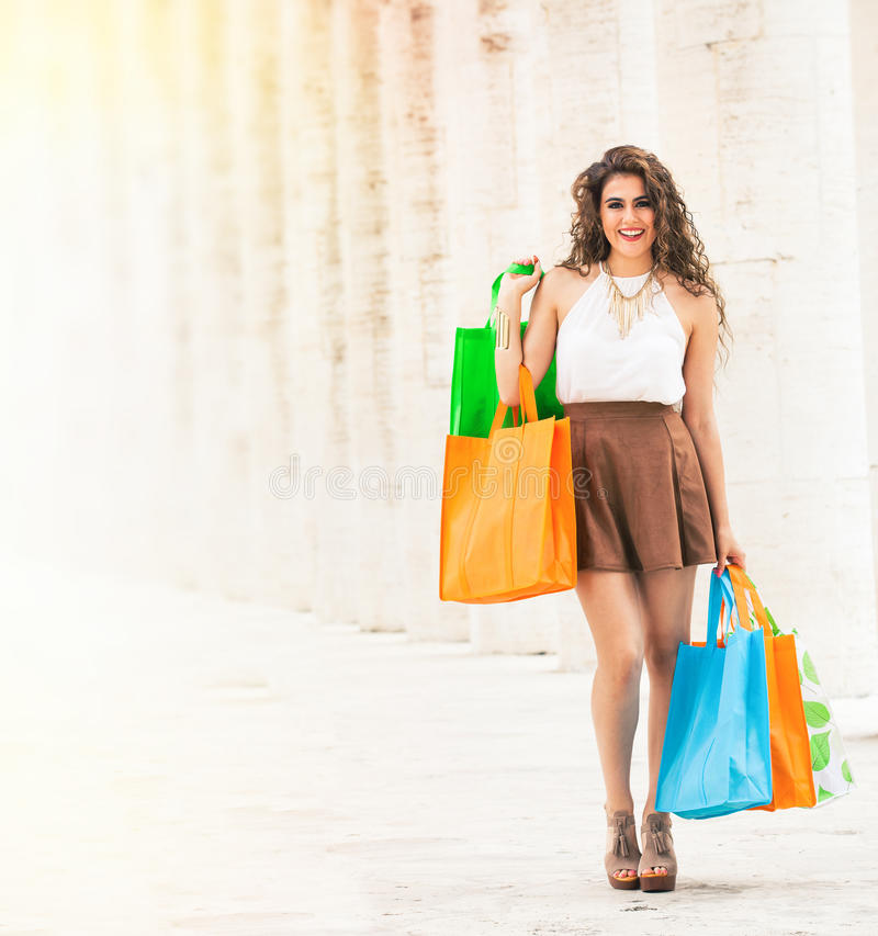 Shopaholic. Shopping love. Beautiful happy woman with bags. stock photography