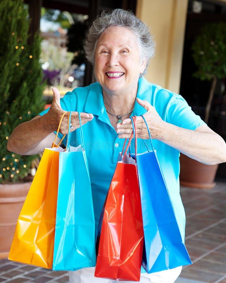 Shopaholic - tvångsmässig shopping royaltyfria bilder