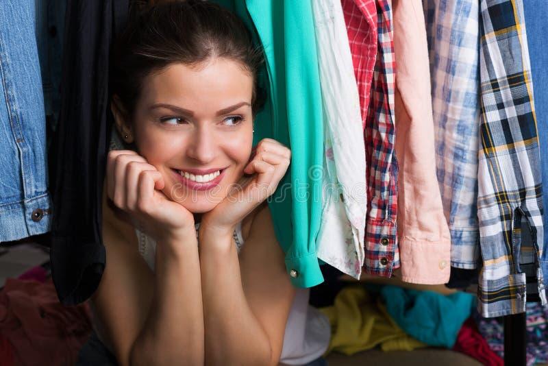Shopaholic woman and her wardrobe stock photos