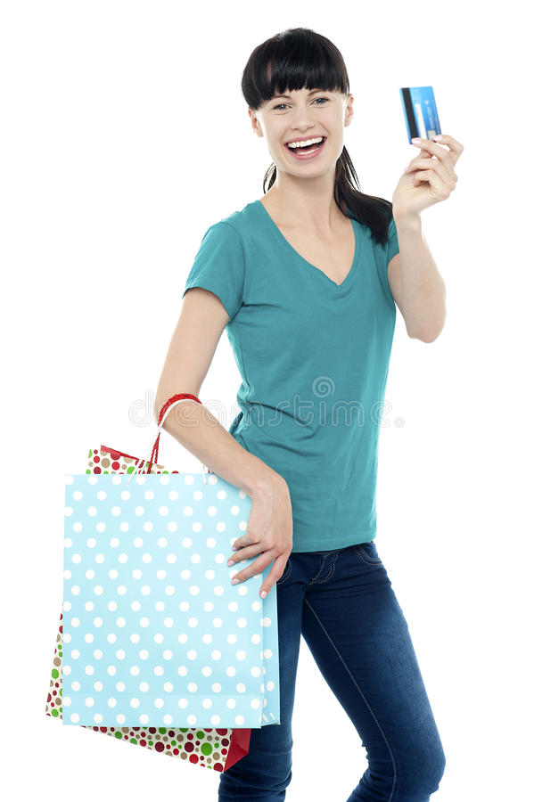 Shopaholic Woman Holding Her Cash Card Up Royalty Free Stock Photos