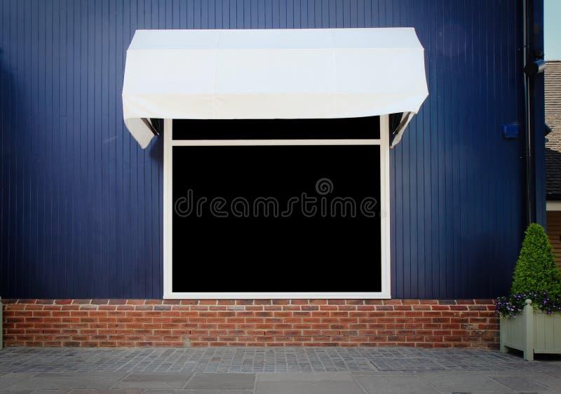Shopfront-Weinlese-Speicherfront mit Segeltuchmarkisen lizenzfreies stockbild