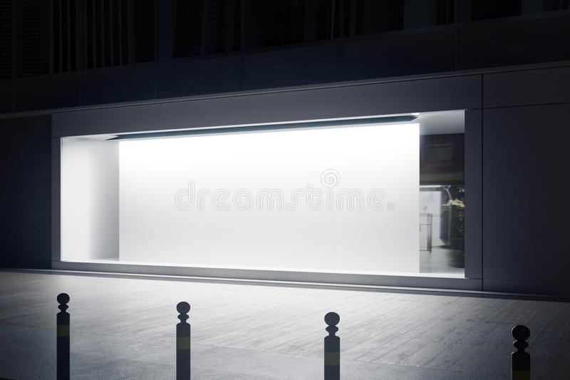 Shopfront with white billboard side. Side view of empty glass shopfront with blank white billboard at night. Retail concept. Mock up, 3D Rendering royalty free illustration