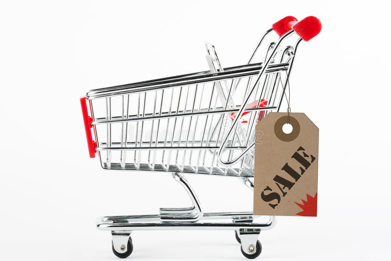 Shoping Cart. Collage of Steel Shoping Cart and Sale Price tag on the white background royalty free stock photo