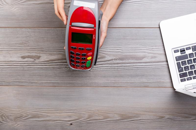 Seller bringing payment terminal to buyer. Shopkeeper hands the Payment terminal terminal to his client stock photo