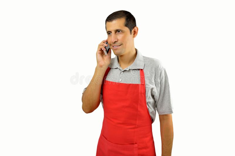 Shopkeeper talking to the phone stock photo