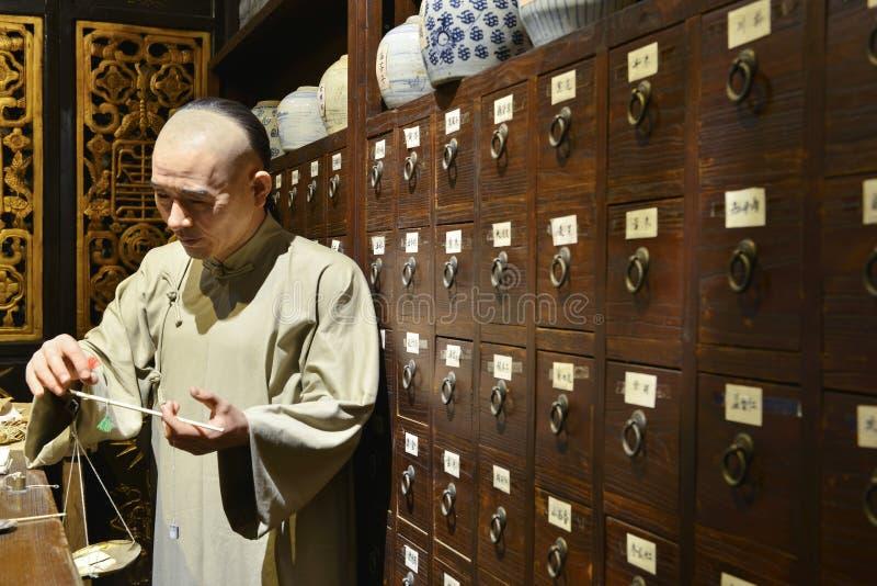 Shoppar växt- medicin för traditionell kines, vaxdiagramet, Kina kulturkonst royaltyfri foto