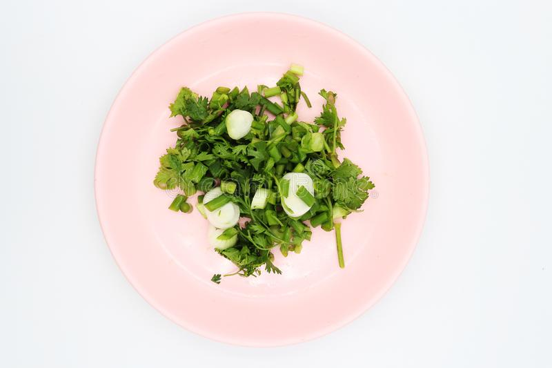 Shopped coriander in pink dish on white background. High resolution image gallery royalty free stock photography