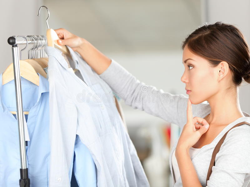 Shopper choosing clothes thinking stock photography