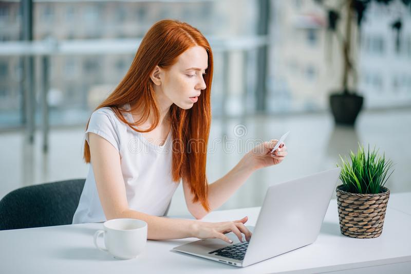 Shopper girl buying online with a laptop and credit card.  stock photography