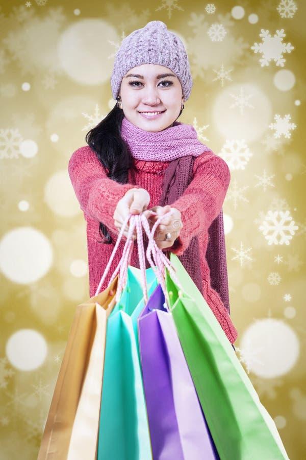 Shopper giving shopping bags stock photo