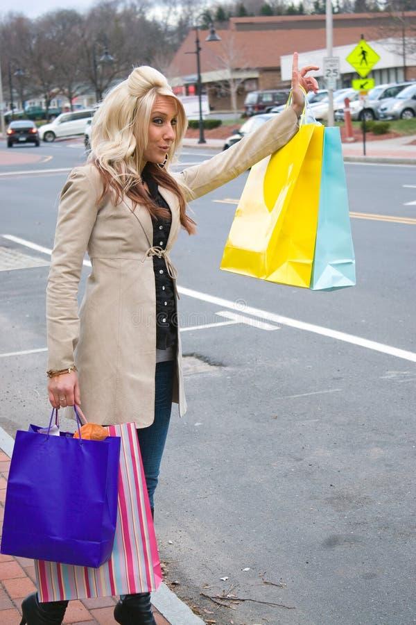 Shopper Hailing a Cab