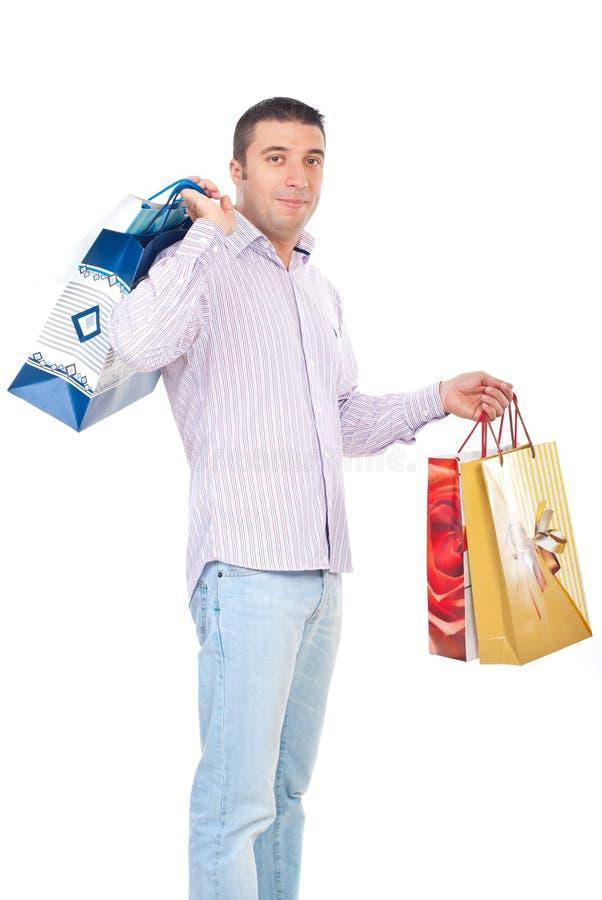 Shopper man carrying bags stock photo
