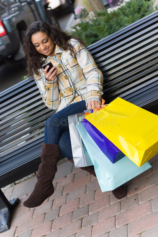 Download Shopper With Mobile Phone stock image. Image of indian - 9279755