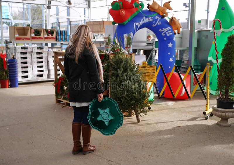 Shopper outdoors browsing for Christmas ornaments. Cromwell, CT USA. Dec 2019. Woman shopper outdoors browsing for Christmas ornaments at a home improvement royalty free stock photography