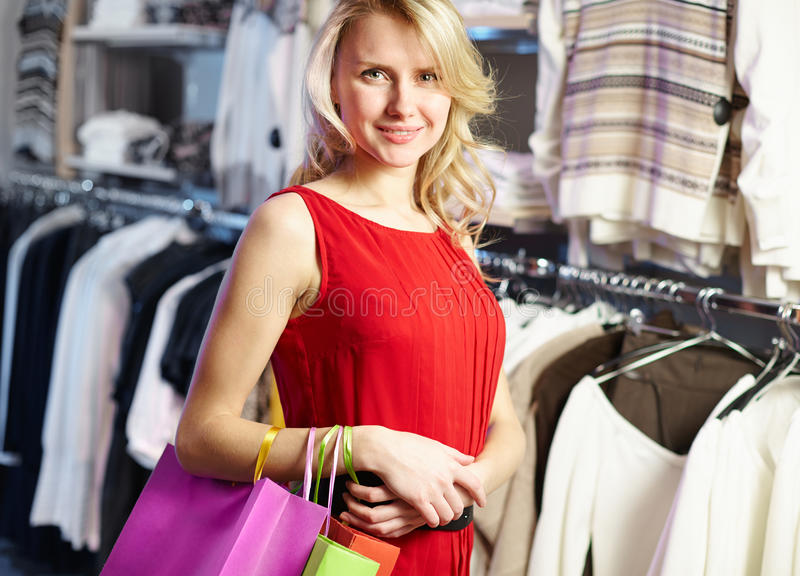 Shopper in red dress royalty free stock photography