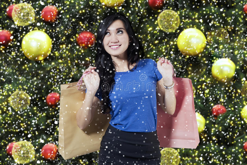 Shopper with shopping bags and christmas ornament royalty free stock photography