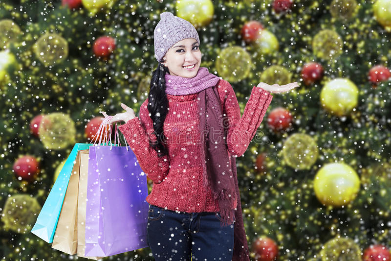 Shopper with sweater and christmas decoration royalty free stock photos