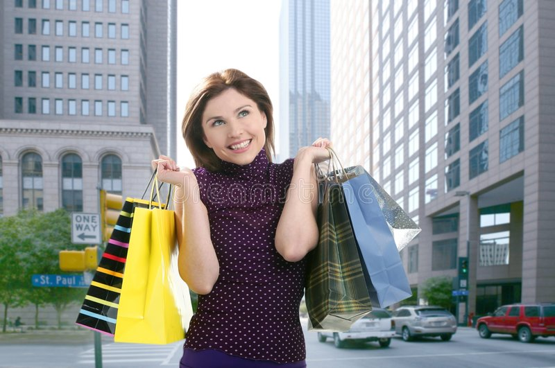 Shopper woman shopping on the city stock image