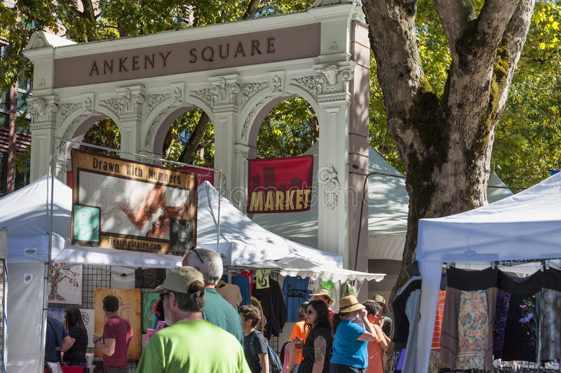 Shoppers and booths under Ankeny Arches Portland Oregon. Portland, Oregon, USA - September 20, 2014: Saturday market booths and shoppers surround the lower half royalty free stock images