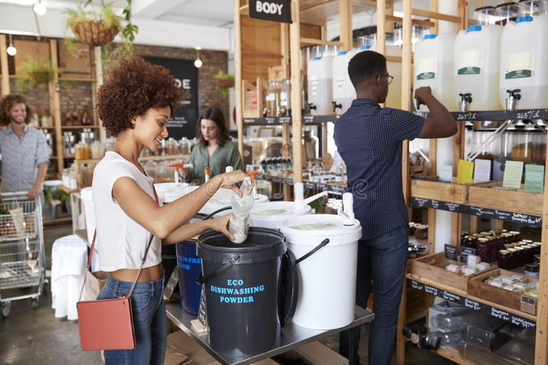 Shoppers Buying Home And Body Products In Sustainable Plastic Free Grocery Store stock image