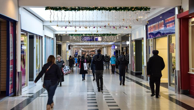 SHoppers at Christmas. Basingstoke, United Kingdom - November 29 2017: Shoppers in Festival Place shopping centre in the run up to Christmas stock images