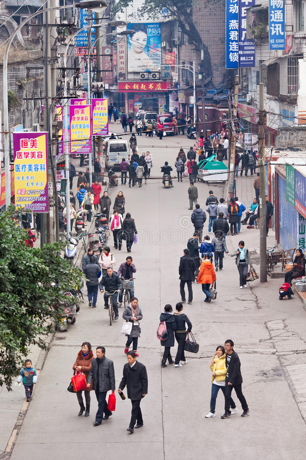 Shoppers ina commercial area in Yibin, China. YIBIN, CHINA- JAN. 9, 2011. Pedestrians on a street in Yibin. Yibin has 4,472,001 inhabitants according to the 2010 stock photography