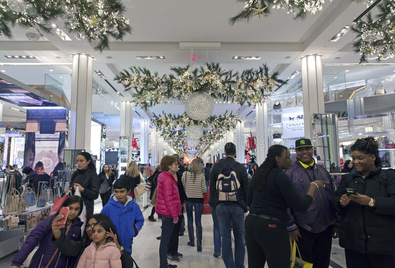 Shoppers inside Macy's at Christmas time in NYC. NEW YORK, NEW YORK, USA - DECEMBER 10: Shoppers visit Macy's department store in Herald Square and 34th street royalty free stock images