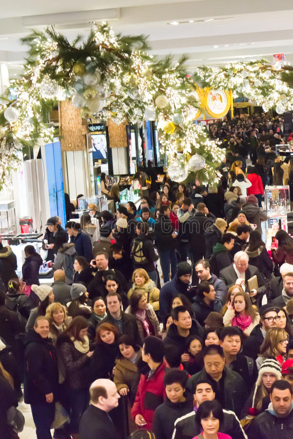 Shoppers at Macys on Thanksgiving Day, November 28. Shoppers flood Macys in New York Citys Herald Square on Thanksgiving night royalty free stock photography