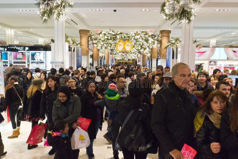 Shoppers at Macys on Thanksgiving Day, November 28. Shoppers flood Macys in New York Citys Herald Square on Thanksgiving night stock photography