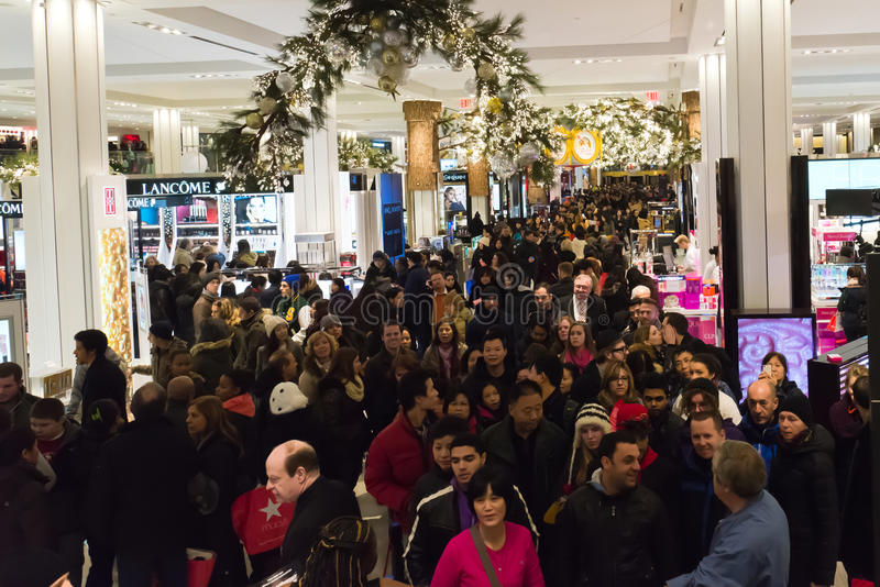 Shoppers at Macys on Thanksgiving Day, November 28. Shoppers flood Macys in New York Citys Herald Square on Thanksgiving night royalty free stock image