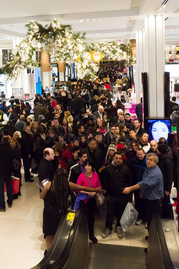 Shoppers at Macys on Thanksgiving Day, November 28. Shoppers flood Macys in New York Citys Herald Square on Thanksgiving night royalty free stock images
