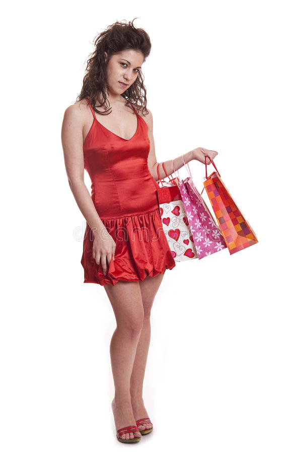 Shoppers in red stock photos