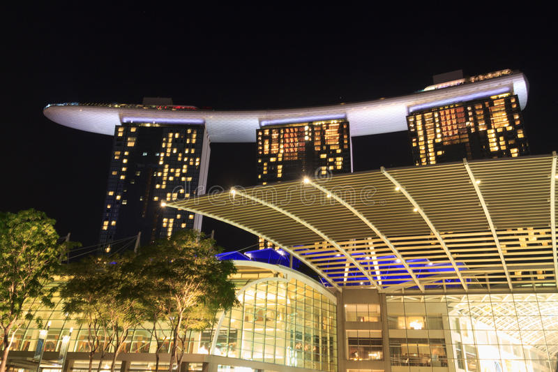 The Shoppes at Marina Bay Sands at night in Singapore stock images