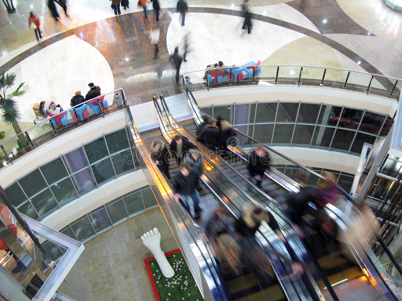 Shopping. Celebratory New Year's shopping in interiors of big shopping centre royalty free stock image