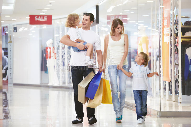 For shopping. A young family of four with children in the store